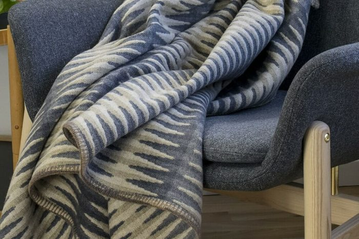 Accent Throw Graphic Pattern in Gray Tones in Chair Detail