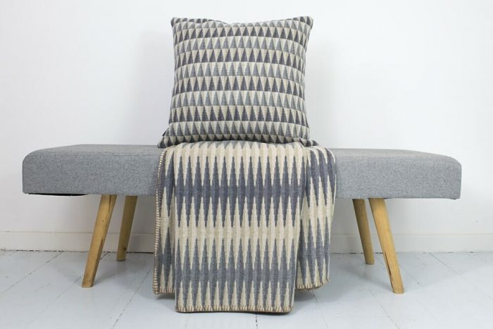 Accent Throw Graphic Pattern in Gray Tones in Chair With Sofa Cushion