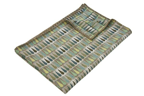 Vibrant green wool throw with leaf pattern