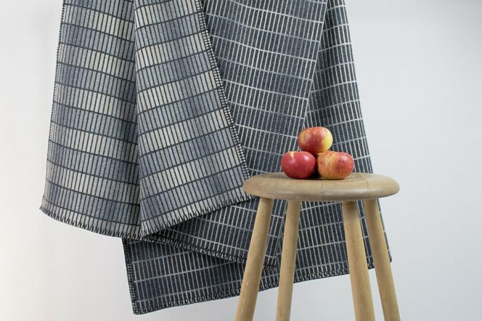 Modern Gray Throw Blanket in clean minimalist design hanging