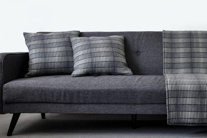 Modern Gray Throw Blanket in clean minimalist design In Sofa