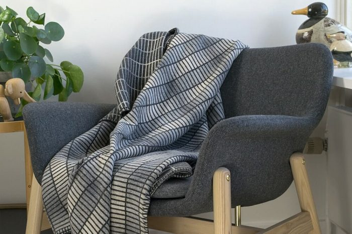 Modern Gray Throw Blanket in clean minimalist design In Chair