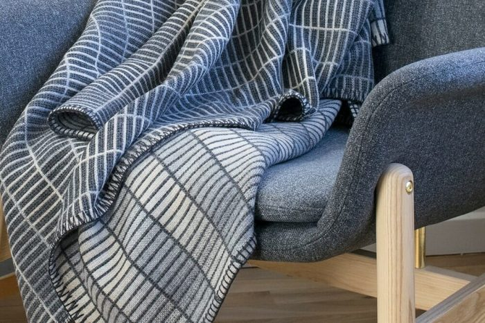 Modern Gray Throw Blanket in clean minimalist design In chair detail