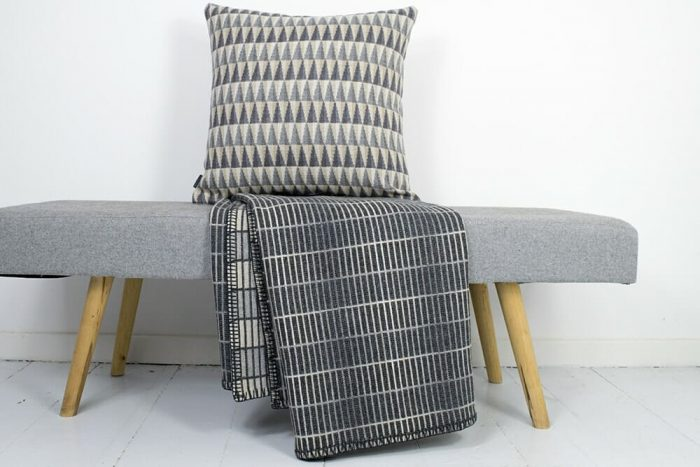 Modern Gray Throw Blanket in clean minimalist design with pillow
