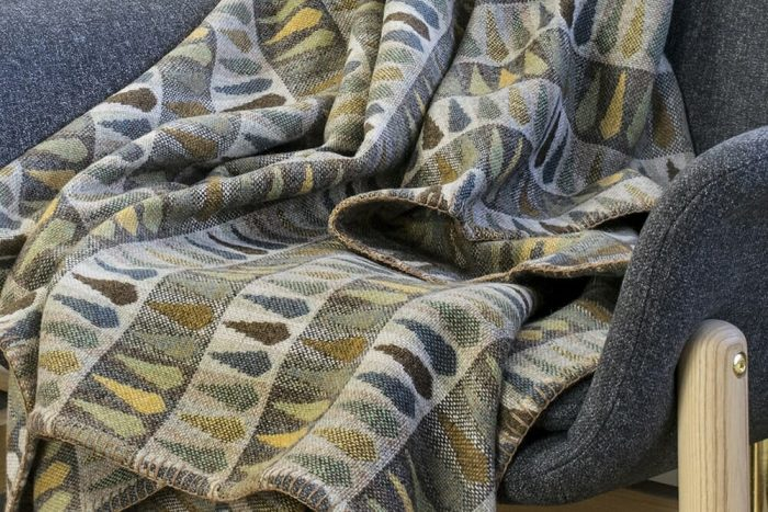 Soft Blanket in Refined Beige Greens and Ochre In Chair Detail